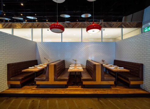 restaurant booth seats enclosed in tiled walls